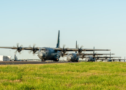 U.S. Air Force C-130J Super Hercules line up on the taxi way as part of an 11-ship formation from Little Rock Air Force Base, Ark., April 15. 2021. The elephant walk quickly launched combat airlift to support an U.S. Army Joint Readiness Training event. (U.S. Air Force photo by Maj. Ashley Walker)