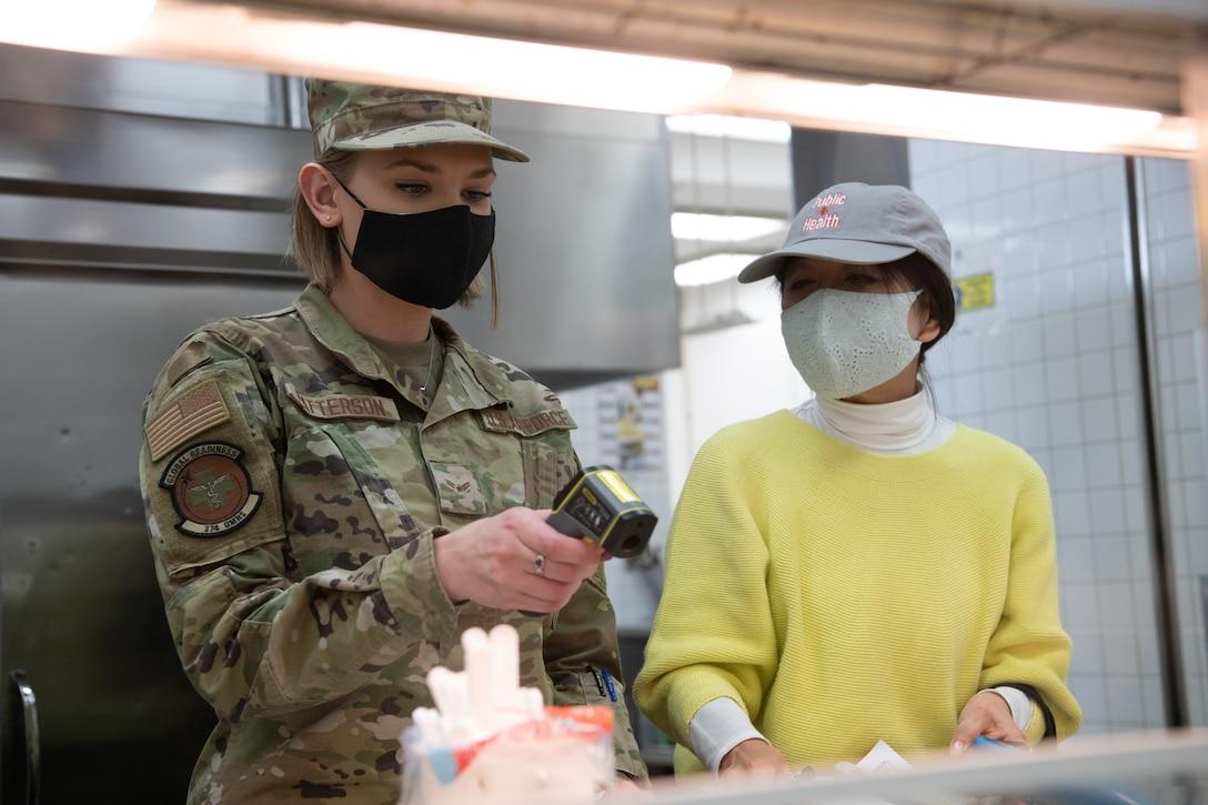 Airman Checks Food Temperature
