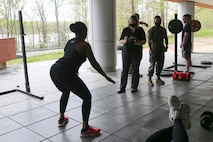 The Marine Corps Recruiting Command G-1 section participates in a Sexual Assault Prevention and Response awareness physical exercise at Marine Corps Base Quantico, Virginia, April 15, 2021. Zuzy Hall, the MCRC Sexual Assault Response Coordinator, and Staff Sgt. Angelica Pulliam, one of MCRC's SAPR Victim Advocates, coordinated both a physical and a mental challenge for MCRC headquarters' personnel to participate in during the month of April as part of the Marine Corps' 17th Annual Sexual Assault Awareness and Prevention Month. The physical challenge coupled learning SAPR statistics with a set of exercises. For example, an American is sexually assaulted every 73 seconds. In recognition, personnel were challenged to complete 73 squats as part of the exercise. The physical challenge consisted of nine different exercises. (US Marine Corps photo by Cpl. Naomi May)