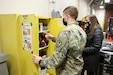 Army Reserve Sgt. Jacob Pulliam, left, operations noncommissioned for 428th Military Police Company, and Andrea Pawlik, area environmental protection specialist, 88th Readiness Division, inspect a storage container for environmental compliance during a visit to the Maple Lane Army Reserve Center in South Bend, Indiana, Feb. 25, 2021. Environmental protection specialists are responsible for ensuring federal, state and local guidelines are followed at Army Reserve facilities.