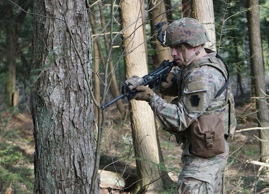 A Soldier from Bravo Company, 1st Battalion, 109th Infantry Regiment, 2nd Infantry Brigade Combat Team, provides security for another Soldier for his squad during enemy prisoner of war drills during training at a training site in Williamsport on April 9, 2021. (U.S. Army photo by Sgt. 1st Class Matthew Keeler)