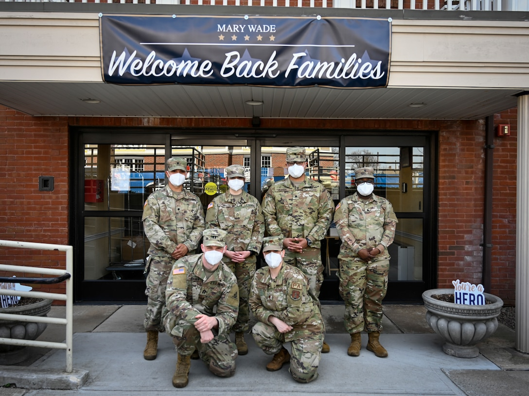 """Soldiers and Airmen from the Connecticut National Guard pose for a picture in front of the Mary Wade Home in New Haven, Connecticut, April 9, 2021. The Connecticut National Guard assisted the Connecticut Department of Public Health in providing COVID-19 vaccinations to nursing home residents and staff through """"Operation Matchmaker."""" (U.S. Air National Guard photo by Tech. Sgt. Steven Tucker)"""