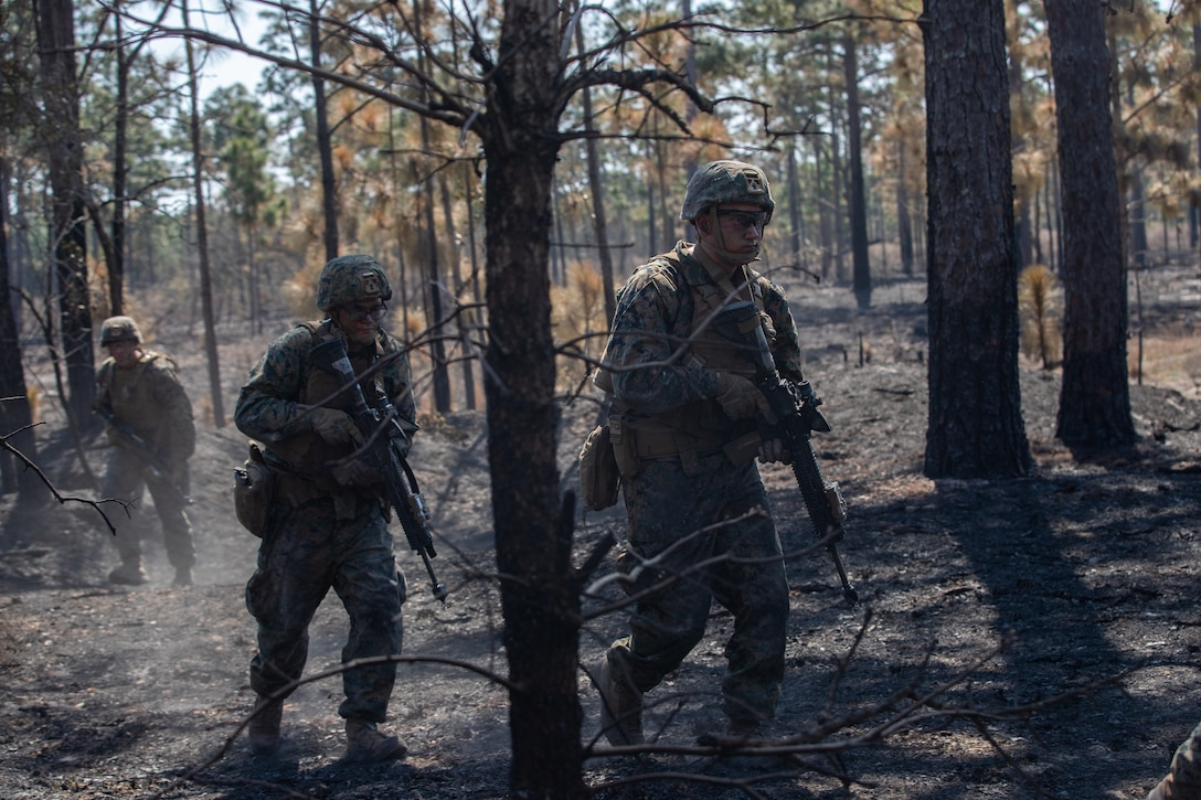 U.S. Marines with Alpha Company, 1st Battalion, 6th Marine Regiment (1/6), 2d Marine Division, advance to the next objective in a squad fire and maneuver training event on Camp Lejeune, N.C.,  April 7, 2021.