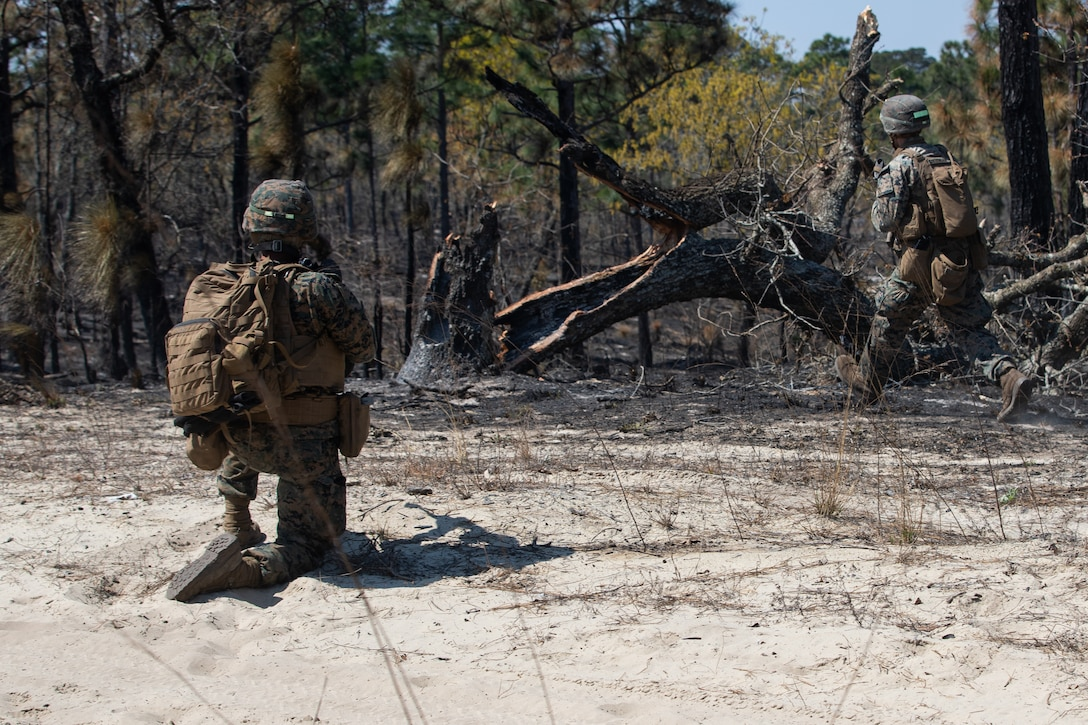 U.S. Marines with Alpha Company, 1st Battalion, 6th Marine Regiment (1/6), 2d Marine Division, buddy rush during a squad fire and maneuver training event on Camp Lejeune, N.C., April 7, 2021.