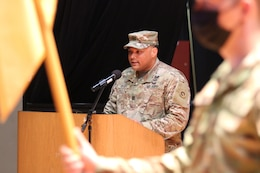 exiting commander speaks at podium