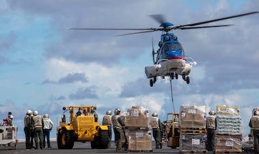 USS Makin Island (LHD 8) conducts a replenishment.