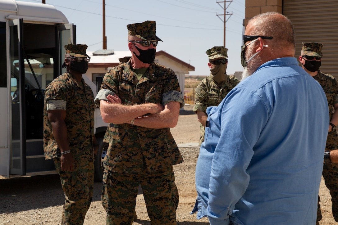 U.S. Marine Corps Maj. Gen. Edward Banta, commander, Marine Corps Installations Command (MCICOM), tours the waste water treatment plant at Marine Corps Air Ground Combat Center, Twentynine Palms, California, April 13, 2021. The Combat Center processes all waste water for all personnel living, working or training on the base. (U.S. Marine Corps photo by Lance Cpl. Jacquilyn Davis)