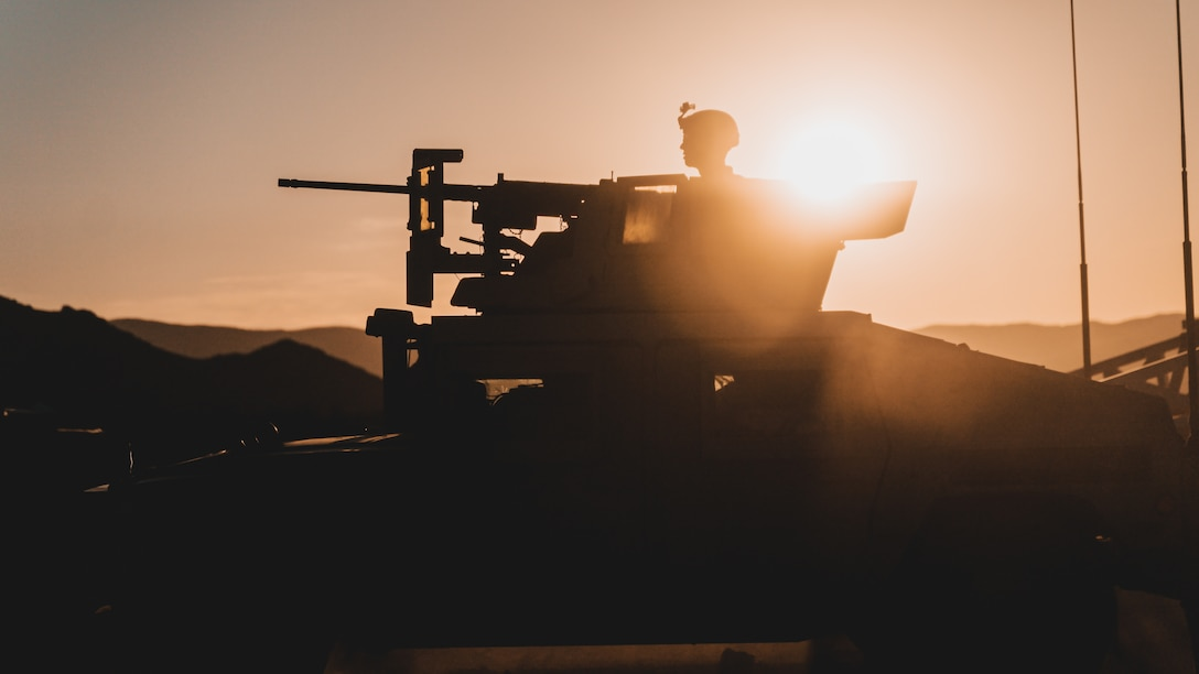 A U.S. Marine with a Combined Anti-Armor Team, 1st Battalion, 5th Marine Regiment, 1st Marine Division, awaits orders during supported company attacks at Range 400 while participating in Integrated Training Exercise 3-21 at Marine Corps Air Ground Combat Center, Twentynine Palms, California, April 12, 2021. The purpose of ITX is to create a challenging, realistic training environment that produces combat-ready forces capable of operating as an integrated Marine Air Ground Task Force. (U.S. Marine Corps photo by Lance Cpl. Colton Brownlee)