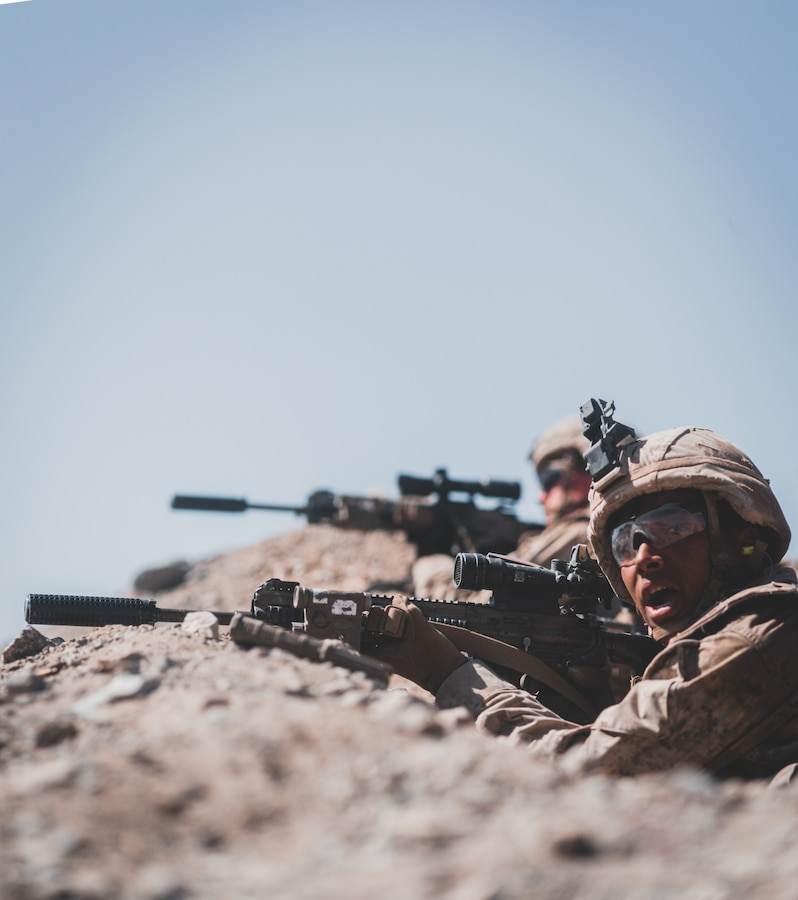 A U.S. Marine with Bravo Company, 1st Battalion, 5th Marine Regiment, 1st Marine Division, calls for an ammo, casualties, equipment count during supported company attacks at Range 400 while participating in Integrated Training Exercise 3-21 at Marine Corps Air Ground Combat Center, Twentynine Palms, California, April 12, 2021. The purpose of ITX is to create a challenging, realistic training environment that produces combat-ready forces capable of operating as an integrated Marine Air Ground Task Force. (U.S. Marine Corps photo by Lance Cpl. Colton Brownlee)
