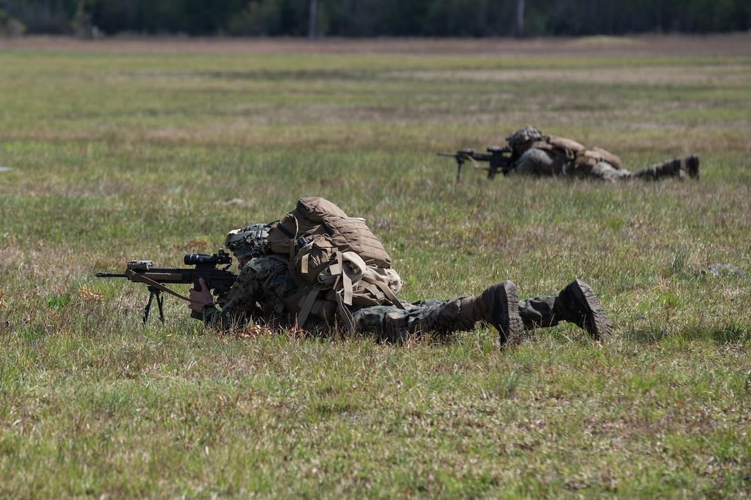 U.S. Marines with Alpha Company, 1st Battalion, 6th Marine Regiment (1/6), 2d Marine Division, aim down range during a squad fire and maneuver training event on Camp Lejeune, N.C., April 13, 2021.