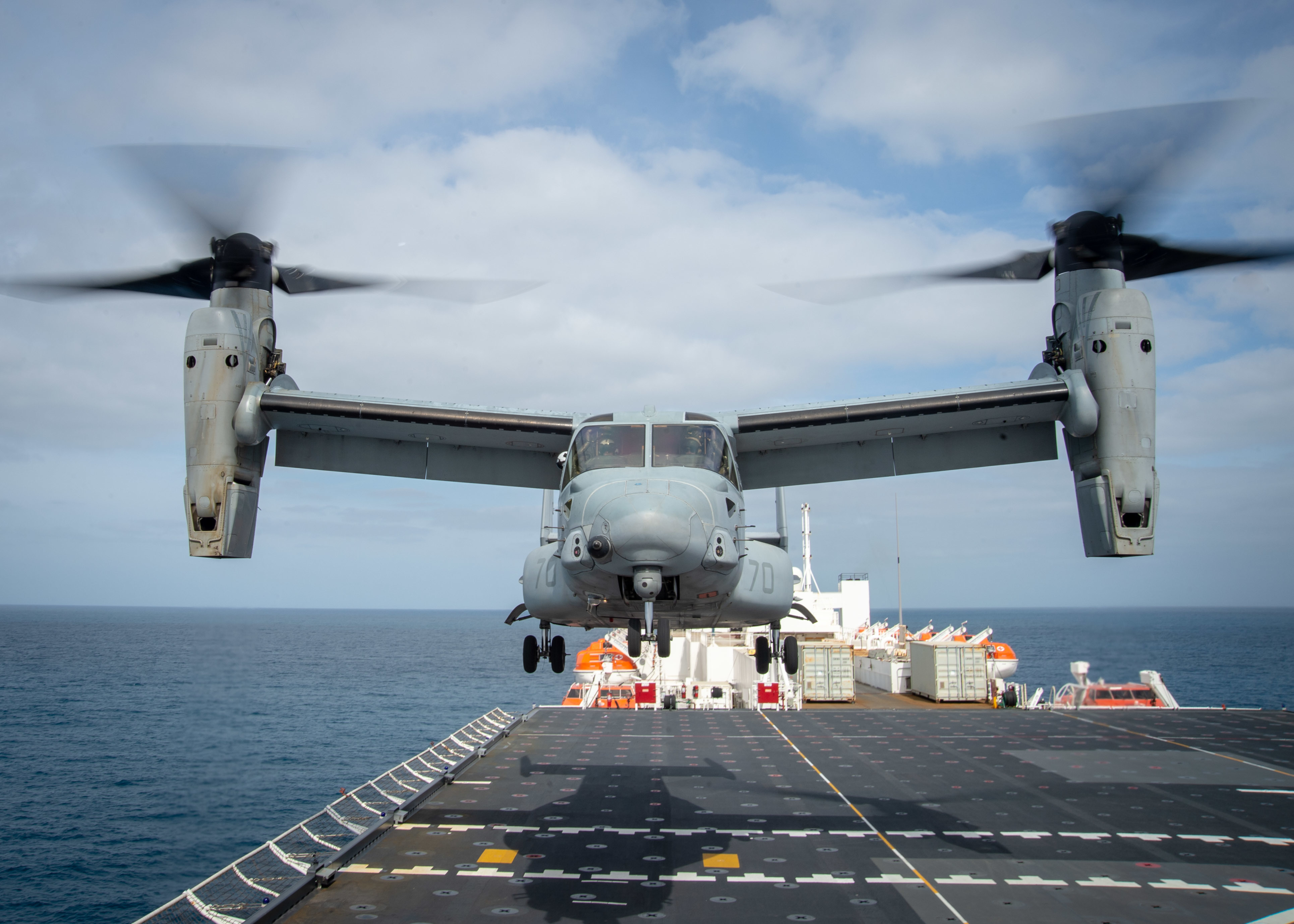 An MV-22B Osprey assigned to Air Test and Evaluation (HX) Squadron 21 of Naval Air Station (NAS) Patuxent River, Md., takes off from Military Sealift Command hospital ship USNS Mercy's (T-AH 19) flight deck.