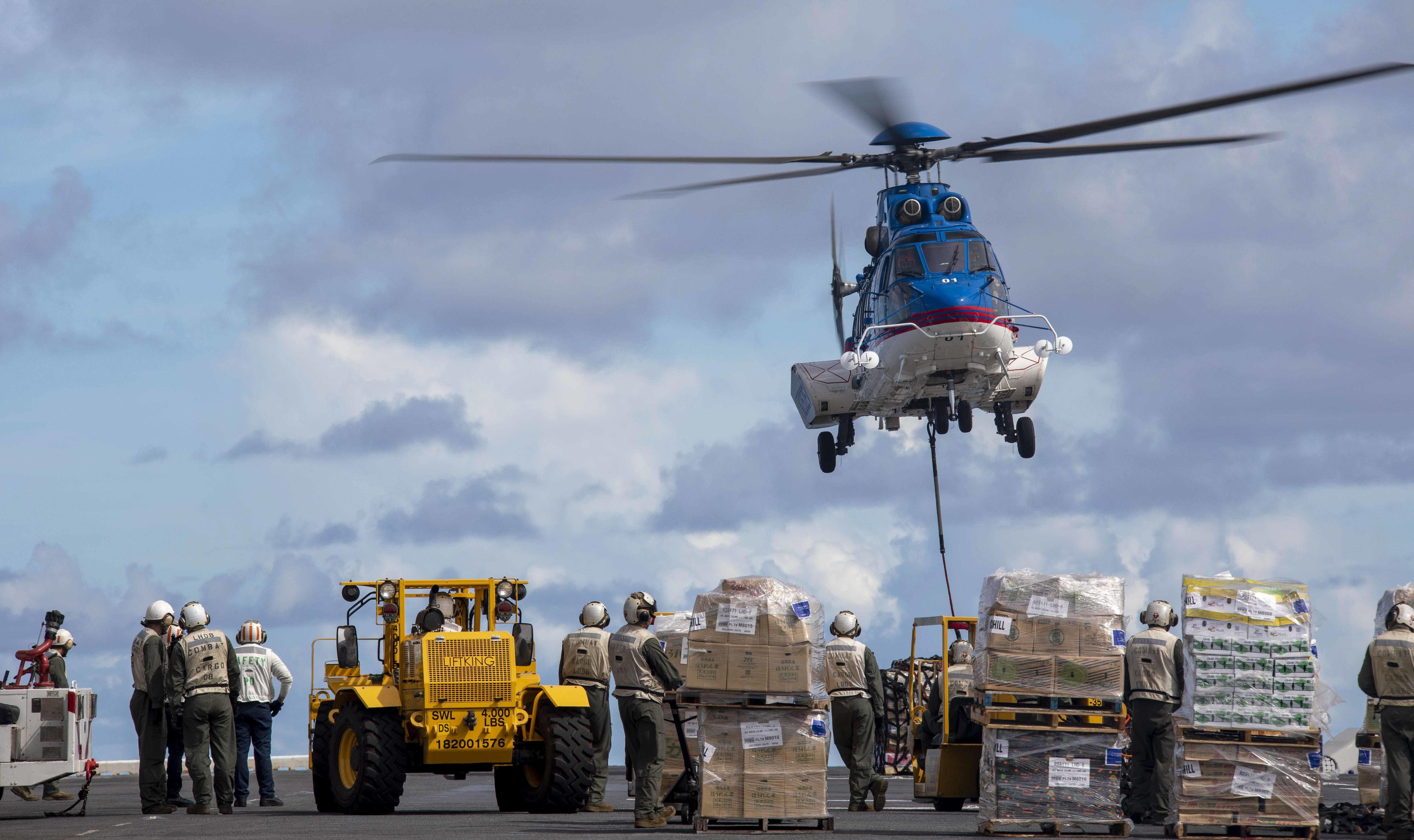 USS Makin Island (LHD 8) conducts a replenishment.