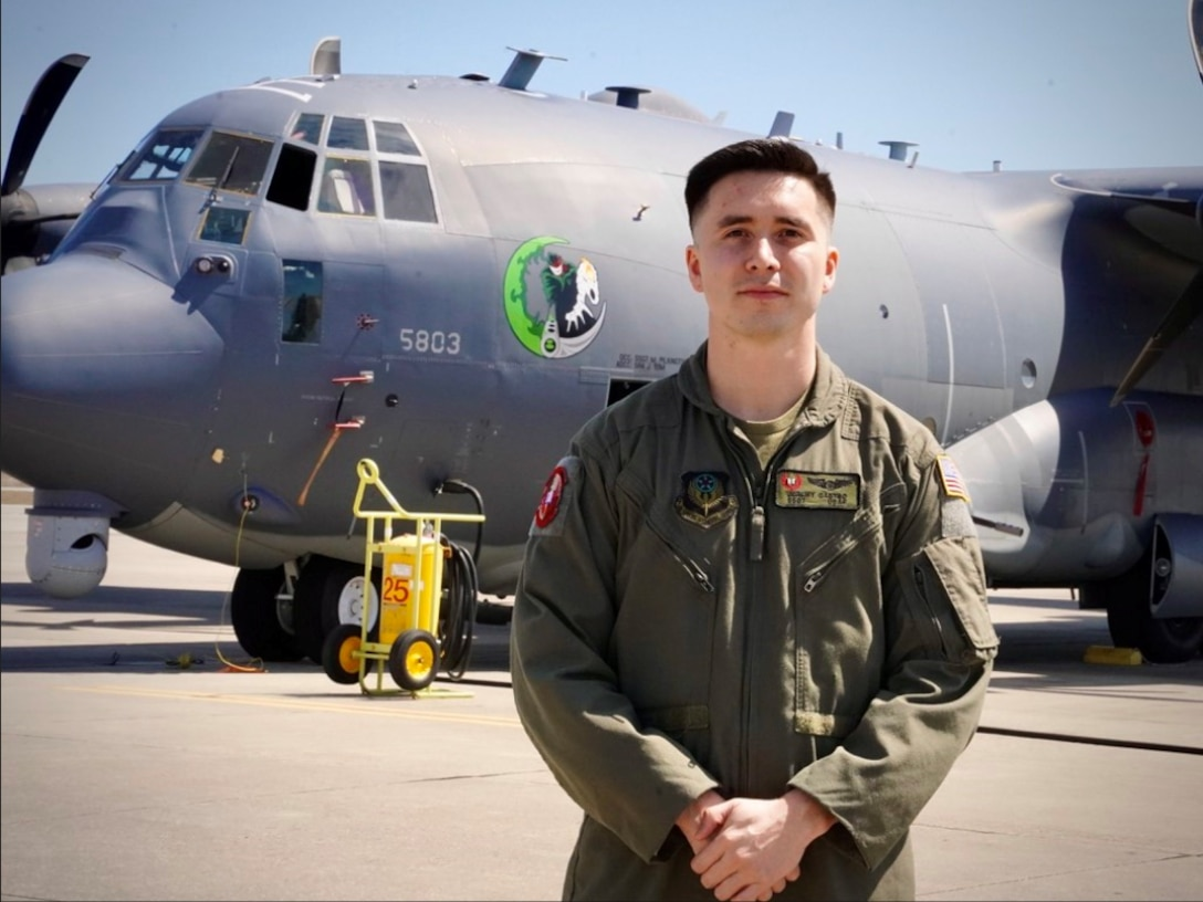 Staff Sgt. Jeremy Castro, 19th Special Operations Squadron special missions aviator poses in front of an AC-130J Ghostrider March 19, 2021, at Hurlburt Field, Florida.