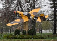 Snow falls around the P-40 Warhawk static display, the Stump Jumper, during a snow storm on Hanscom Air Force Base, Mass., April 16, 2021. Parts of the commonwealth saw nearly five inches after the springtime storm. (U.S. Air Force photo by Linda LaBonte Britt)