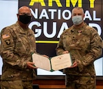 Newly promoted Lt. Col. Michael Barton, of Greenview, Illinois, (right) receives the Meritorious Service Medal from Maj. Gen. Michael R. Zerbonia, Assistant Adjutant General – Army, Illinois National Guard and Commander, Illinois Army National Guard, for Barton's work as the Assistant to the Chief of Staff, Illinois Army National Guard from Jan. 22, 2019 through June 14, 2020. Barton received the award following his promotion ceremony April 5 at Camp Lincoln in Springfield, Illinois.
