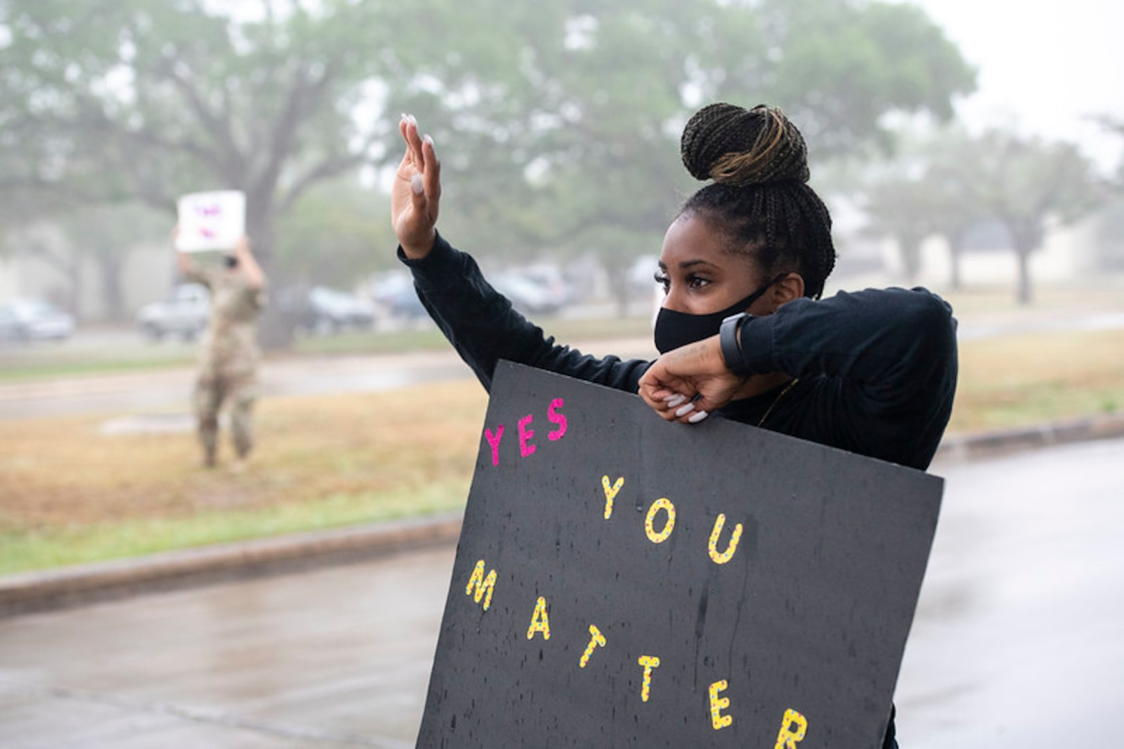 Tech Sgt. Alacia Hatten holds a sign in support of the We Care Day event April. 16, 2021, at Joint Base San Antonio-Randolph, Texas. The event was in support of Month of the Military Child and Child Abuse awareness month. (U.S. Air Force photo by Sabrina Fine)