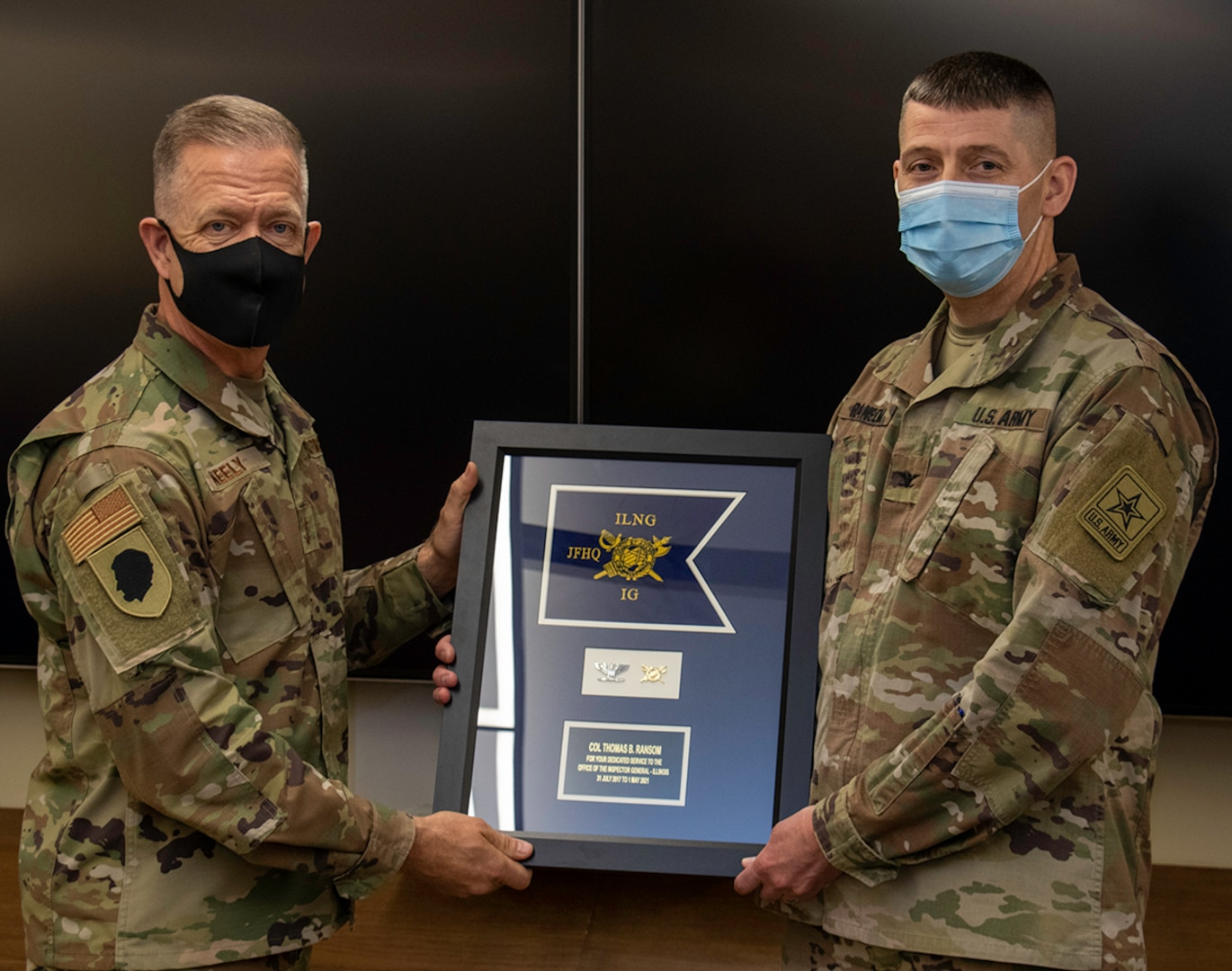 U.S. Army Col. Thomas Ransom (right) of Highland Park, Illinois, Illinois National Guard Inspector General (ILNG IG), receives an Illinois National Guard Inspector General Office Guidon.