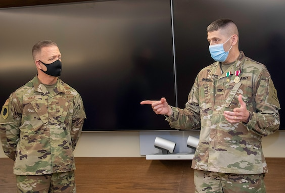 U.S. Army Col. Thomas Ransom, (right) of Highland Park, Illinois, Illinois National Guard Inspector General (ILNG IG), addresses attendees at his farewell ceremony April 9 at Camp Lincoln in Springfield, Illinois. Ransom, who has served as the ILNG IG since 2017, will head to Fort Shafter, Hawaii for his next military assignment as the Deputy Chief of Exercises.