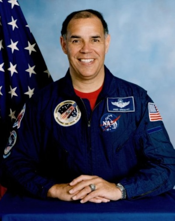 Col. Fredrick Gregory poses for a photo in his NASA uniform