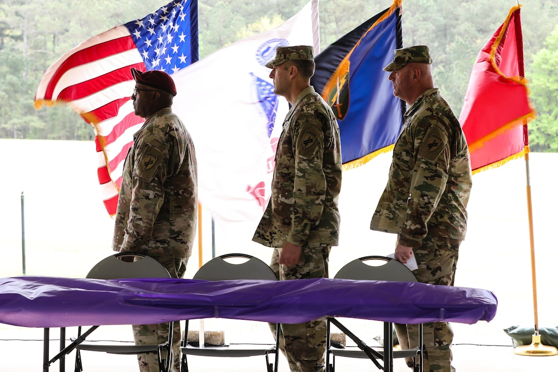 """U.S. Army Reserve Command Sgt. Maj, Petter Trotter (left), the senior enlisted advisor for the U.S. Army Civil Affairs and Psychological Operations Command (Airborne), Brig. Gen. Jeffery Farris (center), commanding general of the 352nd Civil Affairs Command, and Command Sgt. Maj. Michael R. Mielke (right), senior enlisted advisor for the 352nd Civil Affairs Command, begin the award ceremony to finish the 2021 U.S. Army Civil Affairs and Psychological Operations Command (Airborne) Best Warrior Competition at Fort Jackson, S.C., April 10, 2021. The USACAPOC(A) BWC is an annual competition that brings in the best Soldiers across USACAPOC(A) to earn the title of """"Best Warrior"""" among their peers after being evaluated on their individual ability to adapt and overcome challenging scenarios and battle-focused events, testing their technical and tactical abilities under stress and extreme fatigue."""