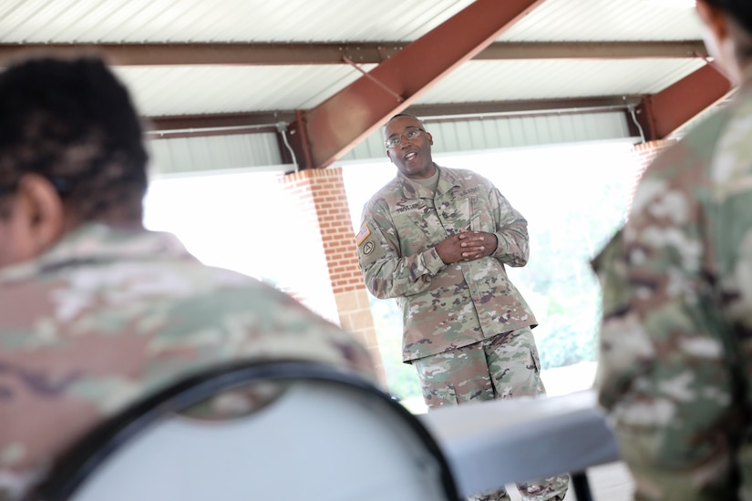 "U.S. Army Reserve Command Sgt. Maj, Petter Trotter, the senior enlisted leader of United States Army Civil Affairs and Psychological Operations Command (Airborne), gives a speech during the award ceremony for the 2021 U.S. Army Civil Affairs and Psychological Operations Command (Airborne) Best Warrior Competition at Fort Jackson, S.C., April 10, 2021. The USACAPOC(A) BWC is an annual competition that brings in competitors from across USACAPOC(A) to earn the title of ""Best Warrior."" BWC tests the Soldiers' individual ability to adapt and overcome challenging scenarios and battle-focused events, testing their technical and tactical skills under stress and extreme fatigue."