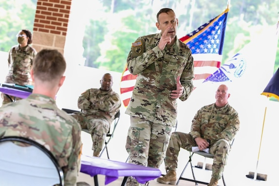 """U.S. Army Reserve Brig. Gen. Jeffery Farris, right, the commanding general of the 352nd Civil Affairs Command, gives a speech during the award ceremony for the 2021 U.S. Army Civil Affairs and Psychological Operations Command (Airborne) Best Warrior Competition at Fort Jackson, S.C., April 10, 2021. The USACAPOC(A) BWC is an annual competition that brings in competitors from across USACAPOC(A) to earn the title of """"Best Warrior."""" BWC tests the Soldiers' individual ability to adapt and overcome challenging scenarios and battle-focused events, testing their technical and tactical skills under stress and extreme fatigue."""