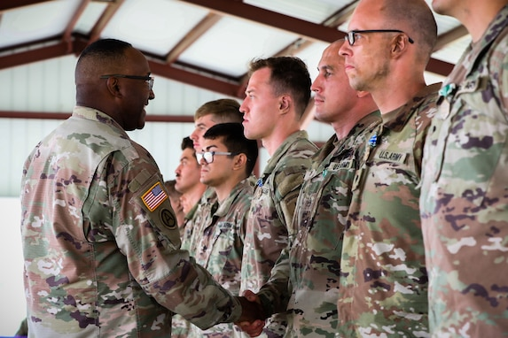 """U.S. Army Reserve Command Sgt. Maj, Petter Trotter, the senior enlisted leader of U.S. Army Civil Affairs and Psychological Operations Command (Airborne), congratulates the competing participants of the 2021 U.S. Army Civil Affairs and Psychological Operations Command (Airborne) Best Warrior Competition at Fort Jackson, S.C., April 10, 2021. The USACAPOC(A) BWC is an annual competition that brings in competitors from across USACAPOC(A) to earn the title of """"Best Warrior."""" BWC tests the Soldiers' individual ability to adapt and overcome challenging scenarios and battle-focused events, testing their technical and tactical skills under stress and extreme fatigue."""