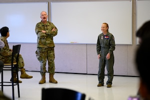 Col. Jeffery Carlton, 120th Airlift Wing vice commander, left, Col. Anita Feugate Opperman, 341st Missile Wing commander, speak to JROTC cadets April 16, 2021, at Great Falls High School, Mont.