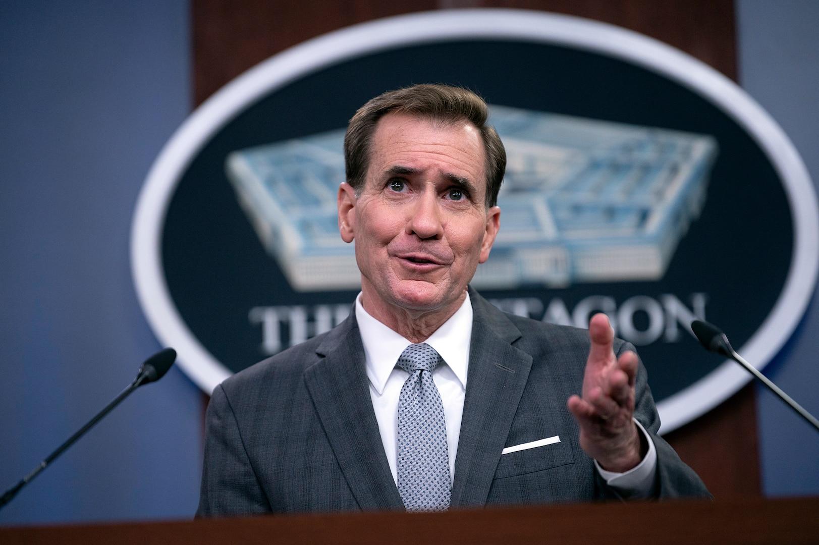 A man briefs the media inside the Pentagon.