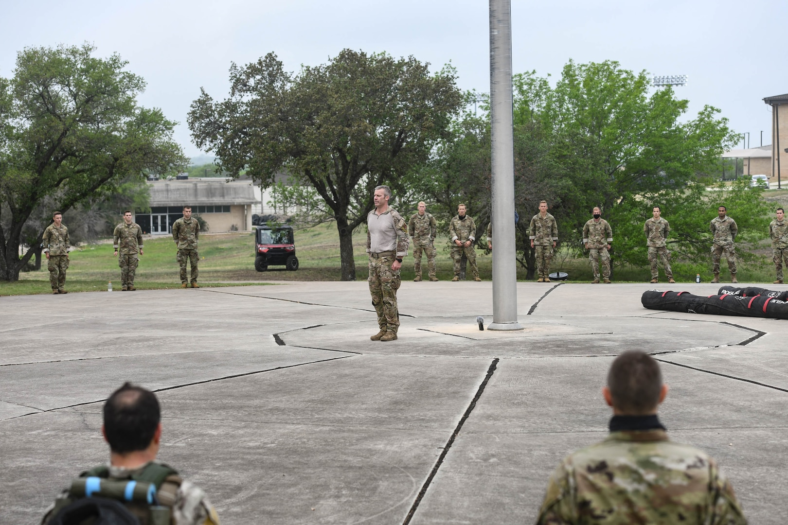 JOINT BASE SAN ANTONIO-CHAPMAN TRAINING ANNEX, Texas—Chief Master Sgt. Todd M. Popovic, Special Warfare Training Wing, or SWTW, command chief, leads a formation in memorial pushups after a memorial log carry for fallen airman, Lt. Col. William Schroeder, at the SWTW located on Joint Base San Antonio-Chapman Training Annex, or JBSA-CTA, Apr. 8, 2021.