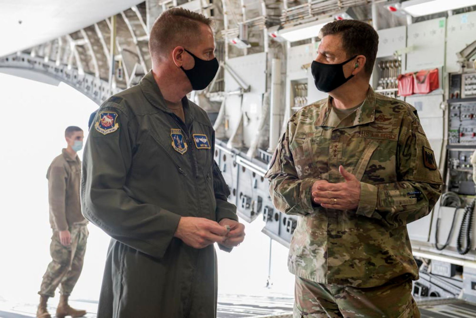 U.S. Air Force Col. Marty Timko, left, wing commander, 167th Airlift Wing, West Virginia National Guard, and Lt. Gen. Michael A. Loh, director, Air National Guard, speak in the cargo area of a C-17 Globemaster III aircraft during Loh's visit at Shepherd Field Air National Guard Base in Martinsburg, West Virginia, March 9, 2021. During his visit, Loh received updates on the unit's current operations and response to the COVID-19 pandemic