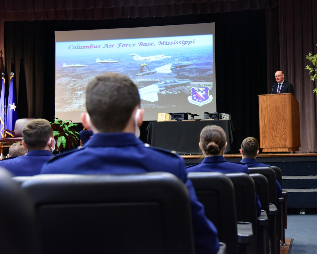 Retired U.S. Air Force Brig. Gen. John Allen, addresses the Specialized Undergraduate Pilot Training graduates of class 21-08 as the keynote speaker, Apr. 16, 2021, on Columbus Air Force Base, Miss. Allen has accumulated more than 6,000 flying hours during his 43 year aviation career, and shared his experiences with the newest aviators. (U.S. Air Force photo by Melissa Duncan-Doublin)