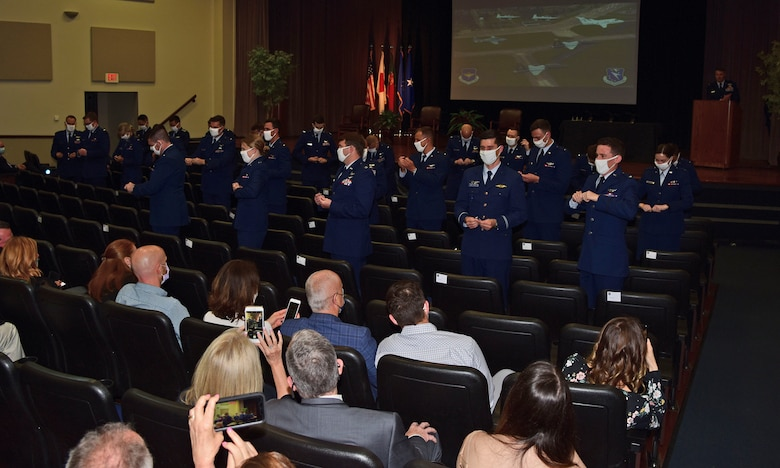 Newly graduated pilots from Class 21-08, take part in the tradition of breaking their first set of pilot wings, Apr. 16, 2021, on Columbus Air Force Base, Miss. At the peak of COVID-19 restrictions, family members were not allowed to attend graduations in person and instead watched via social media livestreams. (U.S. Air Force photo by Melissa Duncan-Doublin)