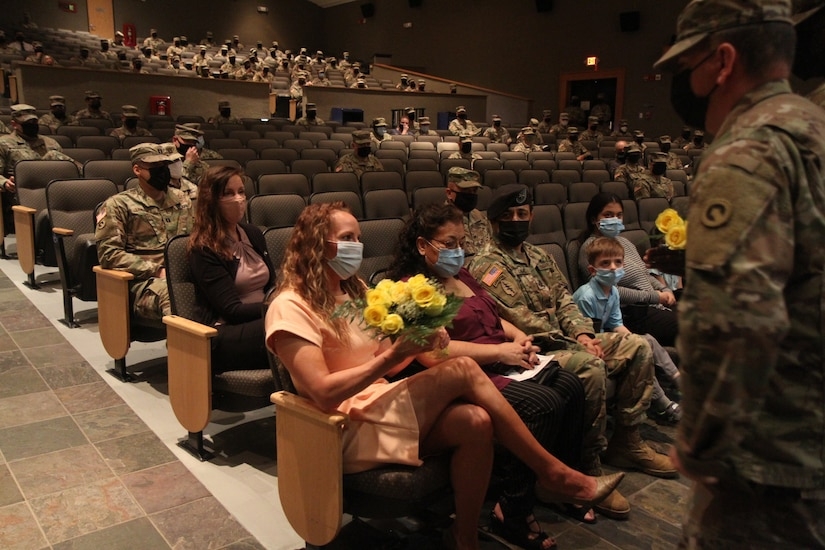 commander's wife receives yellow flowers