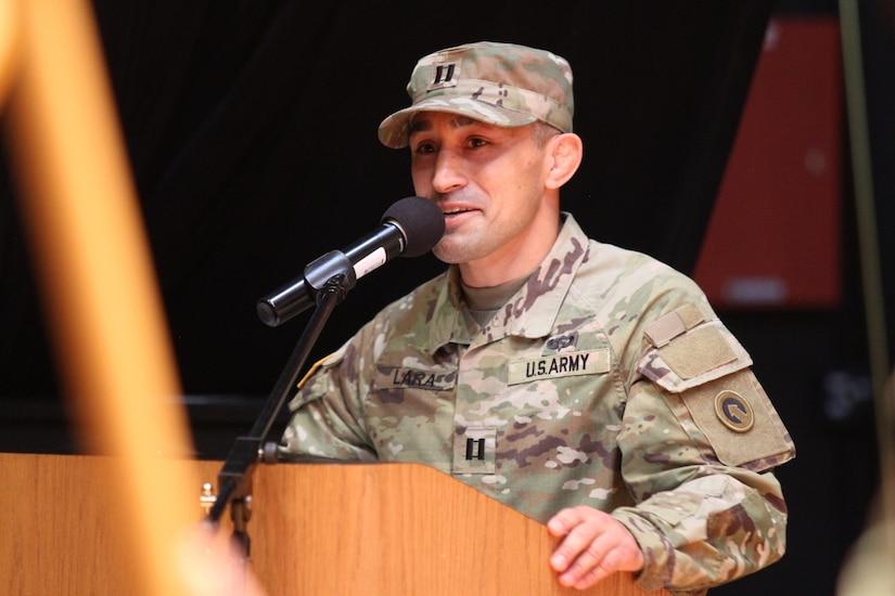 new commander speaks at podium