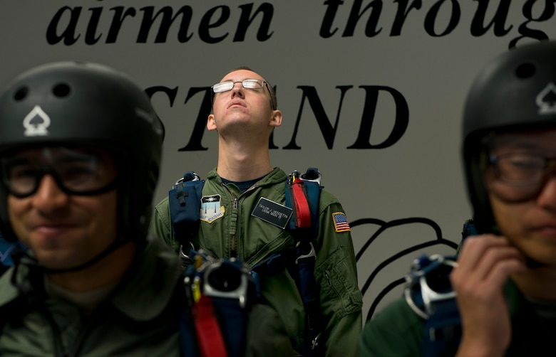 MidshipmanTaylor Vendetta, of the U.S. Navel Academy tries to relax before his first free-fall jump at the U.S. Air Force Academy's AM490 Basic Parachuting course. (U.S. Air Force photo/Tech. Sgt. Bennie J. Davis III)
