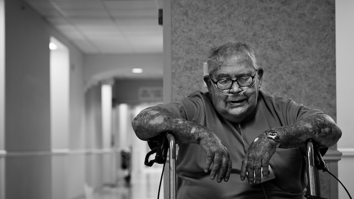 Deteriorating health requires Bill Castle to stop and rest to regain some of his strength while moving from location to location on campus.  (U.S. Air Force photo/Staff Sgt. Andrew Lee)