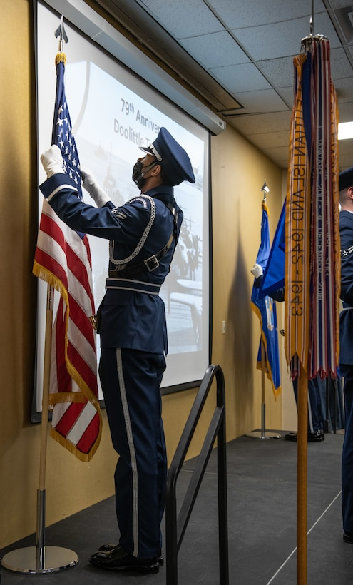 A 28th Bomb Wing Honor Guard member posts the U.S. flag during the 79th Doolittle Raid anniversary ceremony on Ellsworth Air Force Base, S.D., April 16, 2021. The Doolittle Raid took place on April 18, 1942, after Japanese forces launched a surprise bombing on Pearl Harbor.  (U.S. Air Force photo by Airman Jonah Fronk)