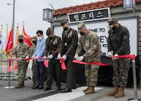 U.S. Marine Corps, U.S. Army, and Republic of Korea personnel cut the ribbon and unveiled the gate during a dedication ceremony in honor of U.S. Marine Corps Brig. Gen. Robert E. Galer, a combat aviator and holder of the Nation's highest decoration, the Medal of Honor, on Camp Humphreys, Pyeongtaek-Si, Republic of Korea, April 16, 2021.