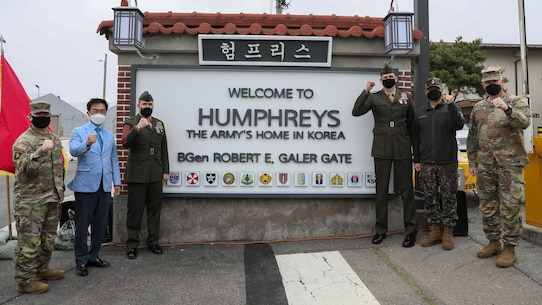 U.S. Marine Corps, U.S. Army, and Republic of Korea personnel pose with the unveiled gate after a dedication ceremony in honor of U.S. Marine Corps Brig. Gen. Robert E. Galer, a combat aviator and holder of the Nation's highest decoration, the Medal of Honor, on Camp Humphreys, Pyeongtaek-Si, Republic of Korea, April 16, 2021.