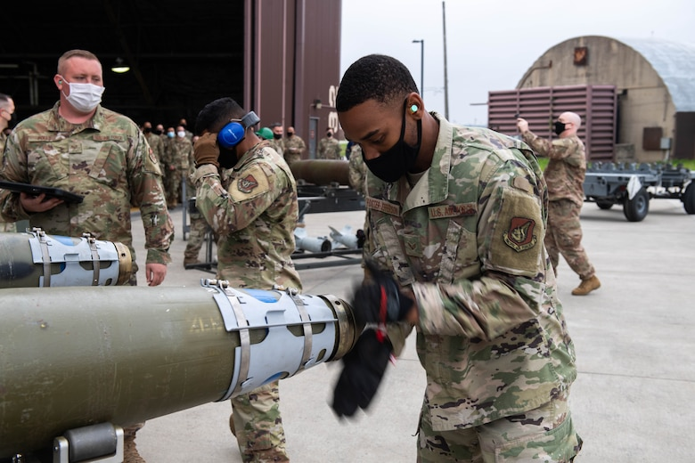 Senior Airman Khalil Foster-Jefferson, 51st Munitions Squadron, competes in the Load Crew of the Quarter Competition at Osan Air Base, Republic of Korea, April 16, 2021. Two teams raced to build and load munitions onto both the A-10 Thunderbolt II and an F-16 Fighting Falcon aircraft. (U.S. Air Force photo by Senior Airman Kevyn Allen)