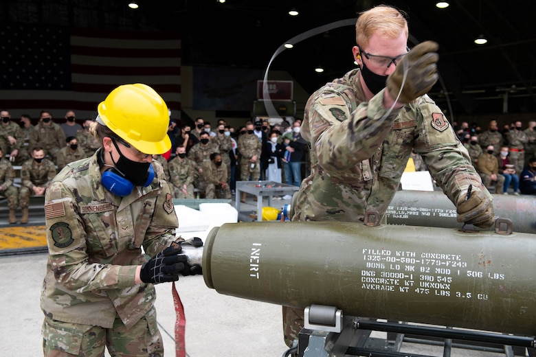 Airman 1st Class Danielle Sonnenberg (left) and Senior Airman Michael Morris, 51st Munitions Squadron, compete in the Load Crew of the Quarter Competition at Osan Air Base, Republic of Korea, April 16, 2021. This competition is held by the 51st Maintenance Group to showcase the Munitions Squadron and Aircraft  Maintenance Units while fostering healthy competition and morale. (U.S. Air Force photo by Senior Airman Kevyn Allen)