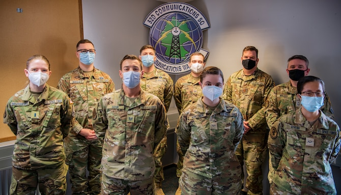 Nine U.S. Space Force Guardians pose for a group photo in the 52nd Communications Squadron heritage room, April 16, 2021.