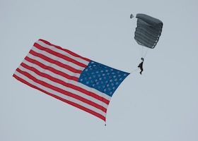 A Special Tactics Airman, assigned to the Kentucky Air National Guard, parachutes over Bowman Field during an aerial demonstration for the Thunder Over Louisville air show in Louisville, Ky., April 17, 2021. This year's event featured aircraft from multiple military and civilian agencies. (U.S. Air National Guard photo by Staff Sgt. Clayton Wear)