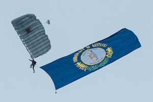 A member of the Kentucky Air National Guard's 123rd Special Tactics Squadron executes a high-altitude, low-opening parachute jump into Bowman Field in Louisville, Ky., April 17, 2021 to open the Thunder Over Louisville air show. The annual event featured more than 20 military and civilian aircraft. (U.S. Air National Guard photo by Dale Greer)