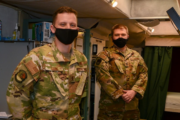 Two 91st Airman pose for a photo inside of a launch control center