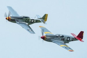 A two-ship P-51 Mustang formation performs an aerial demonstration over Bowman Field in Louisville, Ky., April 17, 2021, as part of the Thunder Over Louisville air show. The top aircraft, nicknamed Swamp Fox, is now privately owned but once belonged to the active inventory of the Kentucky Air National Guard following World War II. (U.S. Air National Guard photo by Dale Greer)