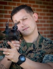 """Cpl. Brandon M. Vogel, a foreign weapons instructor with Division Training Company, Headquarters Battalion, 2d Marine Division, poses for a photo on Camp Lejeune, N.C., April 9, 2021. """"Failure will never overtake me, if my determination to succeed is strong enough,"""" said Vogel, Oakvillie, Conn., native. According to his leadership, Vogel is a driven and highly professional Marine who works daily to mold and mentor future leaders, instructing both junior Marines and his peers alike. Vogle's strict sense of responsibility and professionalism continues to inspire the Marines under his charge. (U.S. Marine Corps photo by Lance Cpl. Brian Bolin)"""