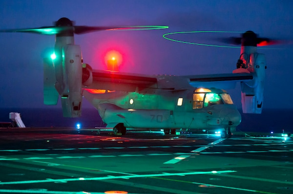 An MV-22B Osprey assigned to Air Test and Evaluation (HX) Squadron 21 of Naval Air Station (NAS) Patuxent River, Md., idles on the flight deck of the Military Sealift ship USNS Mercy (T-AH 19).