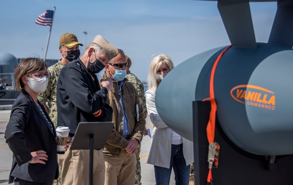 Rear Adm. Lorin Selby, observes a Vanilla Ultra Endurance unmanned aerial vehicle on Pier 12 during Integrated Battle Problem 21 (UxS IBP 21) Distinguished Visitors day at Naval Base San Diego.